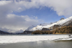 Engadin valley in Switzerland Sils Maria village with snow on Alp mountains and frozen lake Royalty Free Stock Photography