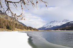 Engadin valley in Switzerland Sils Maria village with snow on Alp mountains and frozen lake Stock Images