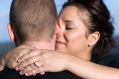 Engaged Couple. A young happy couple that just got engaged.  Shallow depth of field with focus on the diamond engagement ring Royalty Free Stock Photos