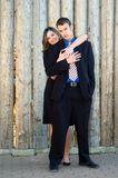 Engaged couple. Standing in front of a wooden wall Stock Photo