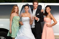 Engaged couple with bridesmaids. Young couple with bridesmaids on wedding-day Royalty Free Stock Photography