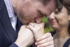 Engaged Couple. Close up of romantic engaged Caucasian and Asian couple kissing with engagement ring Stock Photos