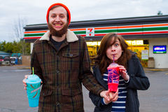 Engaged Couple with 7 Eleven Slurpees Royalty Free Stock Photography