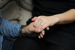 Engaged couple holding hands Royalty Free Stock Photos