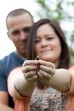 Engaged Couple Holding Ring Stock Image