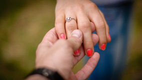 Engaged couple. Loving couple holding hands forever Royalty Free Stock Photo