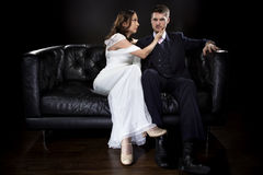 Engaged Couple Modeling Art Deco Style Wedding Suit and Dress royalty free stock images