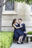Engaged Couple Outside a Church. Young romantic couple engaged to be married outside a church royalty free stock image