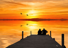 An engaged couple on pier Royalty Free Stock Images
