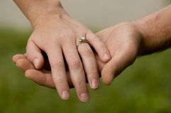 Engaged Couple's Hands Stock Photography