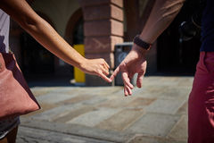 Engaged couple walking in city and holding hands Stock Image