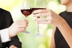 Engaged couple with wine glasses Stock Photo
