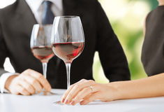 Engaged couple with wine glasses. Picture of engaged couple with wine glasses in restaurant Royalty Free Stock Photo