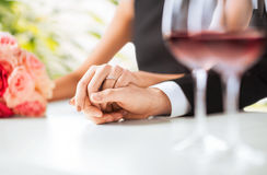 Engaged couple with wine glasses. Picture of engaged couple with wine glasses in restaurant Stock Image