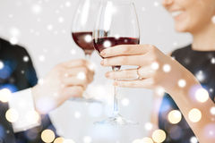 Engaged couple with wine glasses. Love, romance, holiday, celebration concept - engaged couple with wine glasses in restaurant Stock Image
