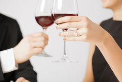 Engaged couple with wine glasses Royalty Free Stock Photo