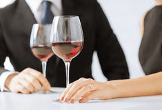 Engaged couple with wine glasses Stock Images