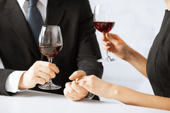 Engaged couple with wine glasses Stock Photos