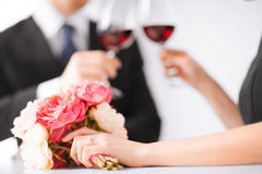 Engaged couple with wine glasses Royalty Free Stock Images
