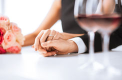 Engaged couple with wine glasses Royalty Free Stock Photography