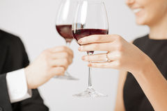 Engaged couple with wine glasses Royalty Free Stock Photos