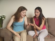 Engaged girl shows her friend Stock Image