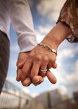 Engaged people holding hands Stock Images