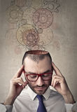 Engaged thoughts. Portrait of man which leave his head gear Stock Photography