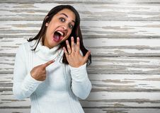Engaged Woman with ring excited against wood. Digital composite of Engaged Woman with ring excited against wood stock images