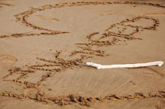 Engaged Written in Sand. Engaged written in the sand with engagement ring Stock Photos