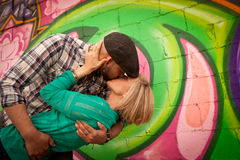 Engaged Young Couple Kissing. Engaged couple kissing while man dips female Royalty Free Stock Images