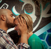 Engaged Young Couple Kissing. Engaged couple kissing on forehead Royalty Free Stock Photography