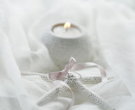 Engagement. Ring wrapped with a pink bow royalty free stock photography