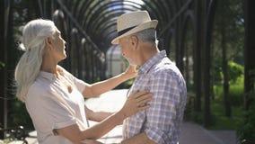 Engagement of beautiful senior couple outdoors