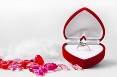 Engagement composition #1. Engagement ring in a heart-shaped box on white background Royalty Free Stock Photos