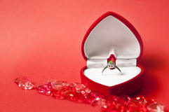 Engagement composition #2. Engagement ring in a heart-shaped box on red background Royalty Free Stock Photography