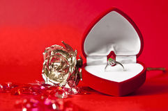 Engagement composition #3. Engagement ring in a heart-shaped box on red background Royalty Free Stock Image