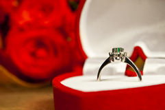 Engagement coposition - ring and roses Royalty Free Stock Photo