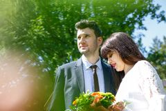 Engagement couple posing in park royalty free stock photography