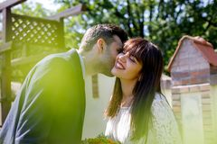 Beautiful wedding couple posing in park stock images