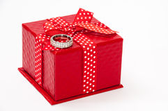 Engagement diamond ring and red gift box with red bow Royalty Free Stock Photography