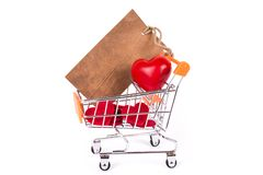 Engagement expensive wedding retail buyer concept. Close up studio photo of beautiful beauty fashion affectionate red little heart. Full pushcart brown card stock image