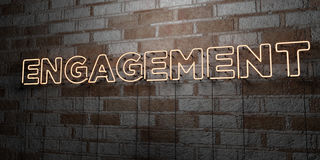 ENGAGEMENT - Glowing Neon Sign on stonework wall - 3D rendered royalty free stock illustration. Can be used for online banner ads and direct mailers Royalty Free Stock Photos