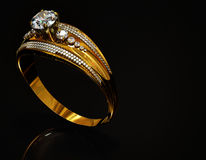 Engagement gold ring with jewelry gem. Gold ring with diamond gem jewelry. Luxury jewellery bijouterie with crystal gemstone for people in love. Frontal view Royalty Free Stock Images