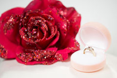 Engagement gold ring and a rose Royalty Free Stock Image