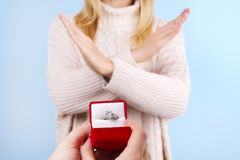 Engagement / marriage / wedding proposal refusing / rejection / not accepting scene. Close up of man handing the expensive gold pl royalty free stock photos