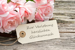 Engagement. Pink roses and card to Engagement Royalty Free Stock Photography