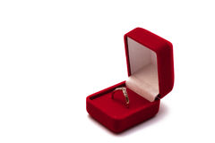 Engagement proposal. Engagement ring in an open red box isolated on white Royalty Free Stock Images