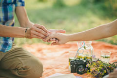 Engagement proposal. Engagement ring proposal hands close up in picnic Royalty Free Stock Photos