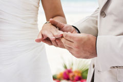 Engagement ring. Groom giving an engagement ring to his bride Royalty Free Stock Images